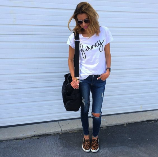 a074e80e57 how to wear a graphic tee. graphic tee paired with distressed denim. via hello  fashion blog